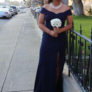 A long navy blue formal dress.